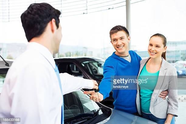 Happy Couple Buying Car