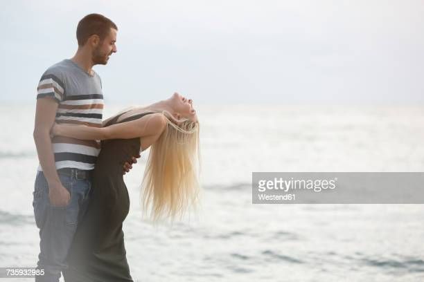 Happy couple by the sea
