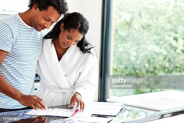 Happy couple calculating expenses