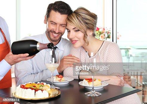happy couple celebrating with wine and cake : Stock Photo