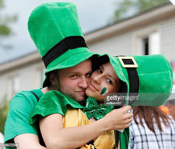 Happy couple dressed as leprechauns for Saint Patrick's Day