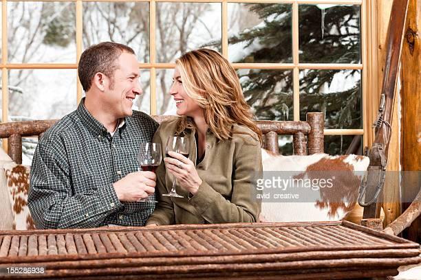 Happy Couple Drinking Wine in Ski Lodge