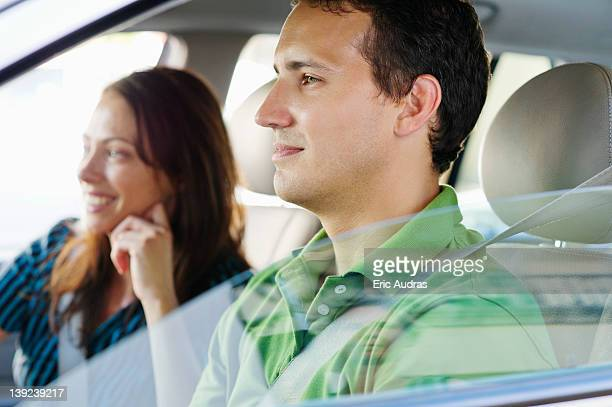 Happy couple driving a car