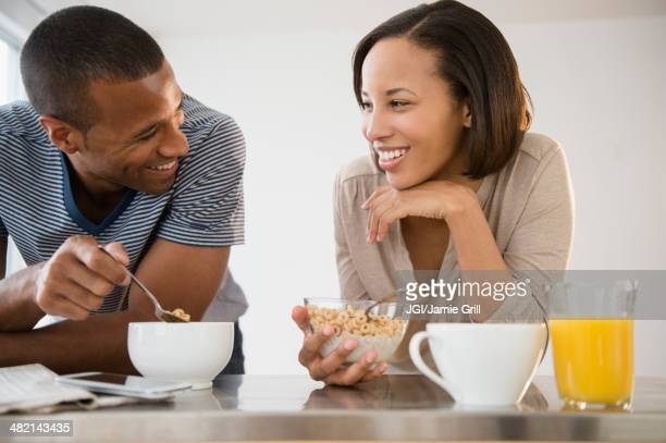 Happy couple eating cereal