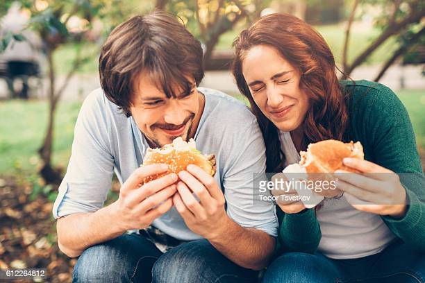 Happy couple eating