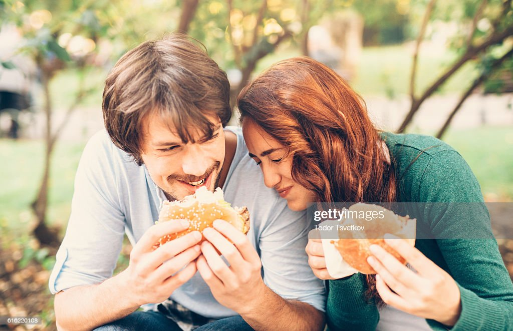 Happy couple eating : Stock Photo