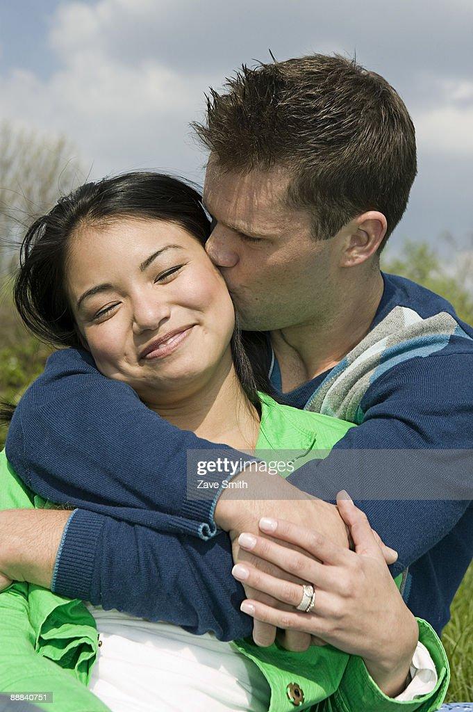 Happy couple embracing : Stock Photo