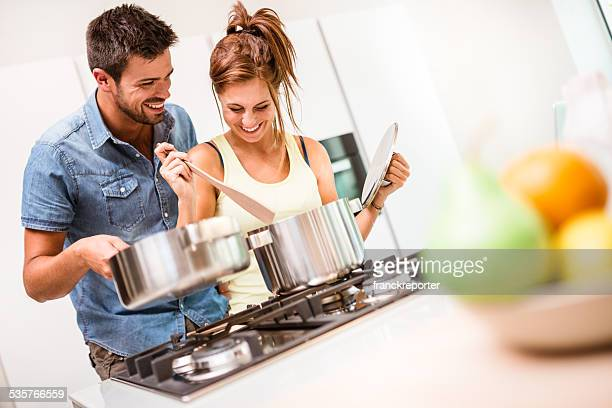 Happy couple embracing together on the kitchen