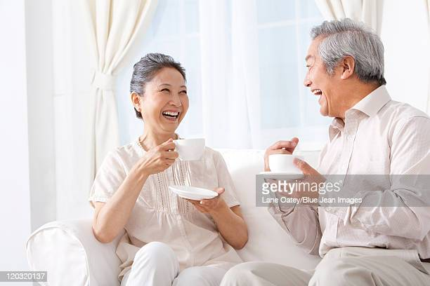 Happy Couple Enjoying Tea
