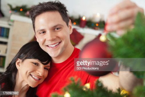 People Decorating For Christmas decorating christmas tree stock photo | getty images