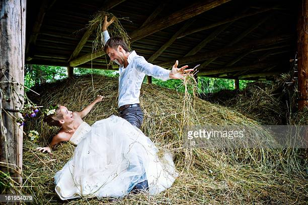 Happy couple have fun in the hayloft