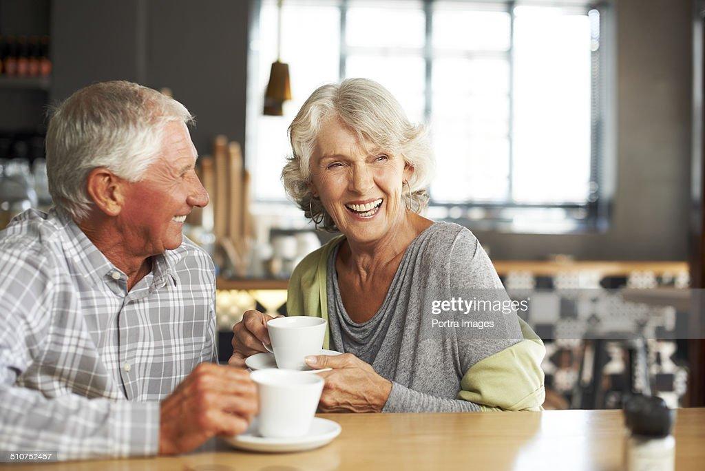 Happy couple having coffee at restaurant