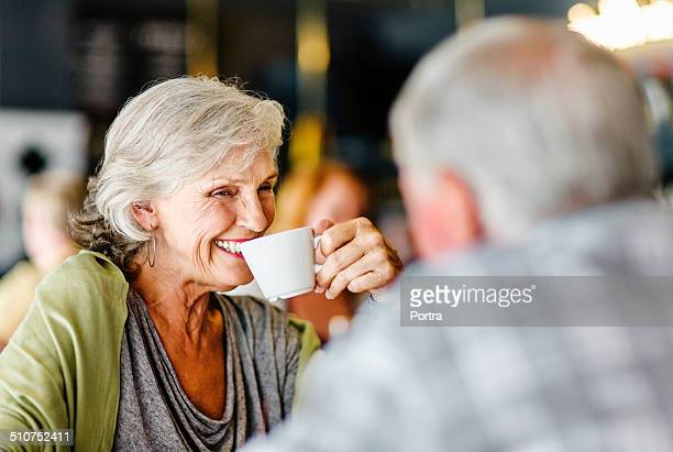Happy couple having coffee in restaurant