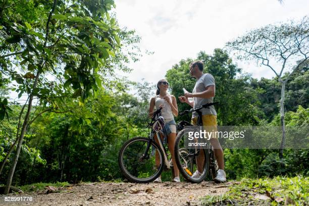 Happy couple having fun cycling outdoors