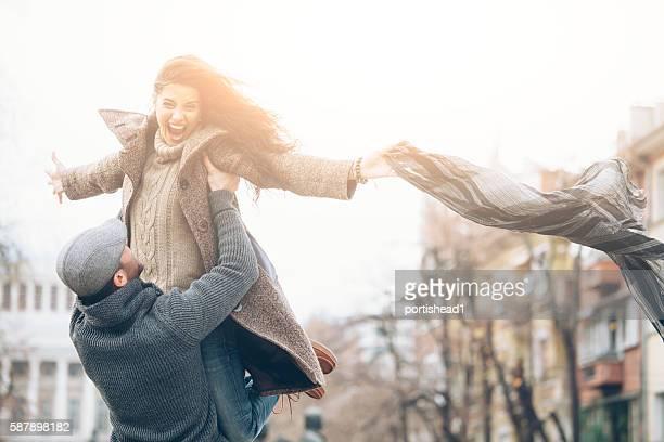 Happy couple having fun on street