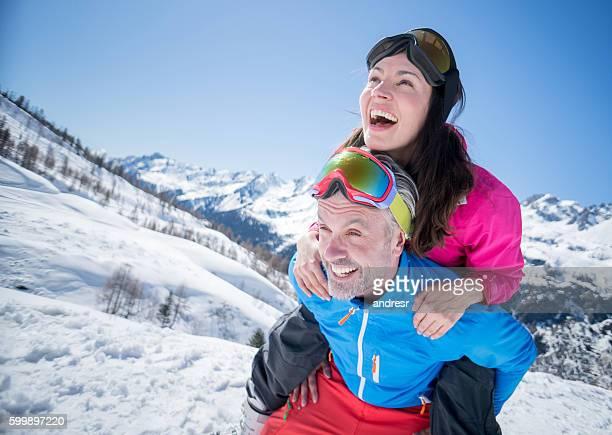 Happy couple having fun skiing
