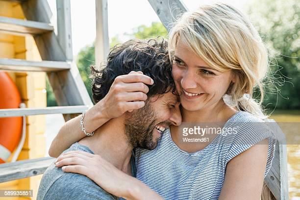 Happy couple hugging on a house boat