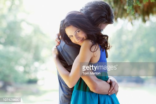 Happy couple hugging outdoors : Stock Photo