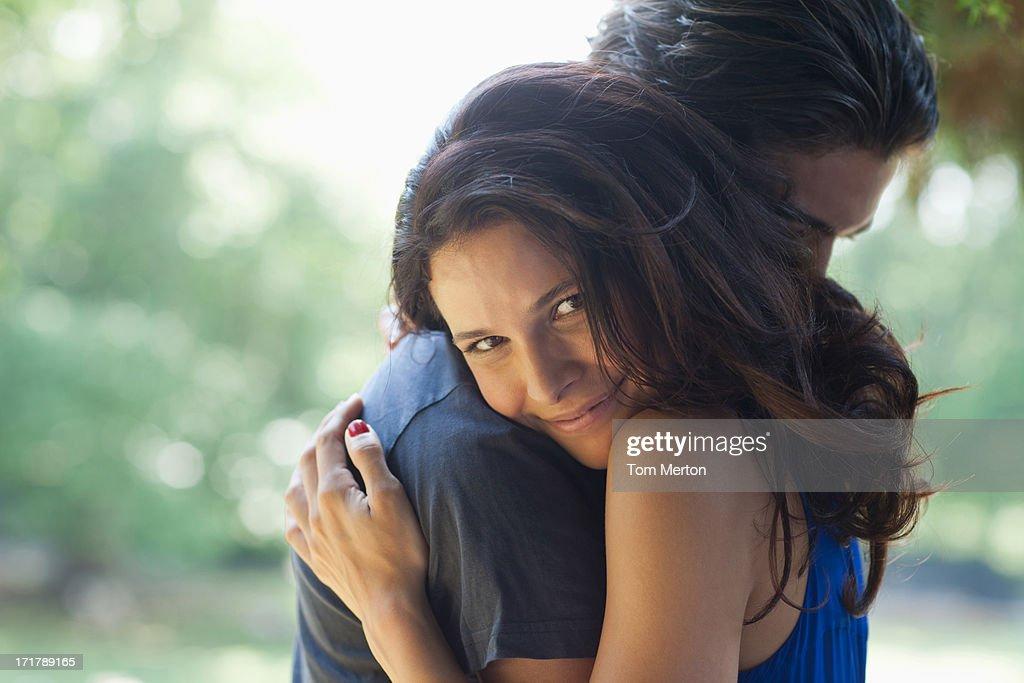 Happy couple hugging outdoors : Stock Photo