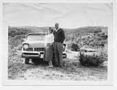 Happy couple in 1950 with car