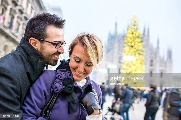 Happy couple in front of Duomo Cathedral, Milan