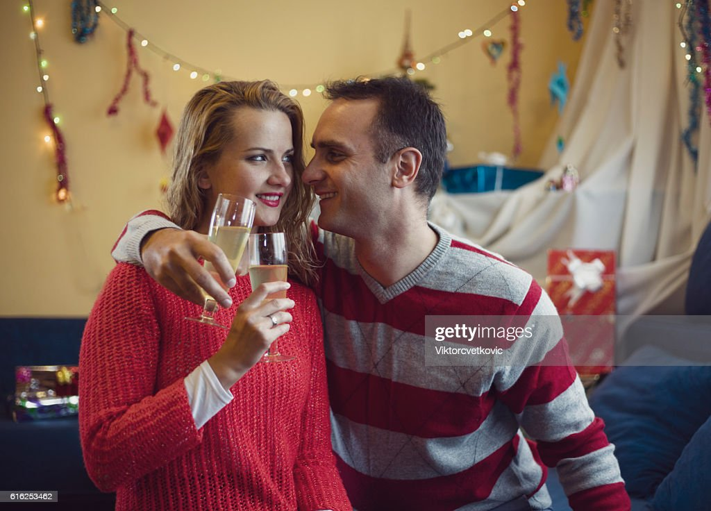 Happy couple in love at Christmas time and New Year. : Foto de stock