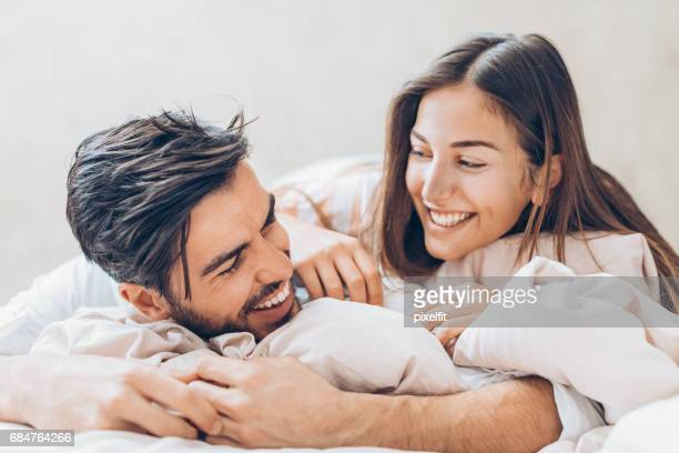 Happy couple in love in the bed