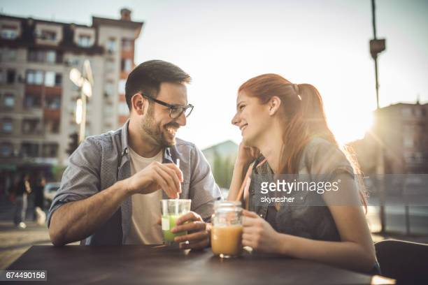 Happy couple in love talking to each other in a cafe.