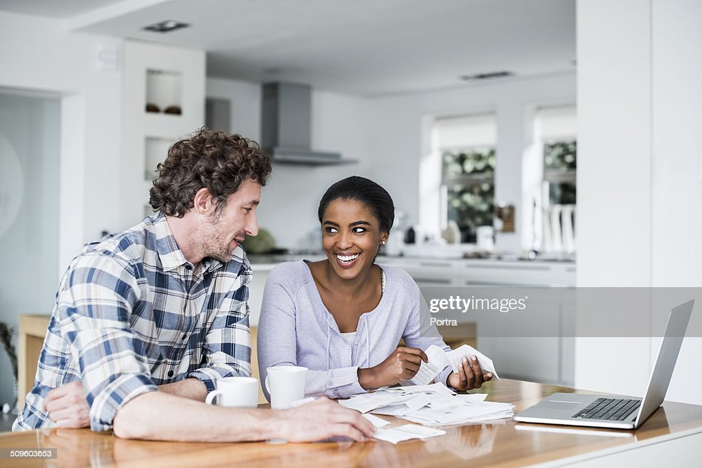 Happy couple making online payment