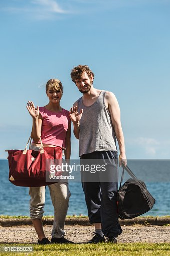 Happy couple man and woman with sport bags. : Stock Photo