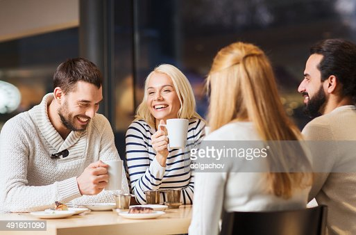 happy couple meeting and drinking tea or coffee : Stock Photo
