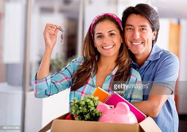 Happy couple moving house