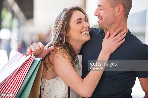 Happy couple on a shopping spree