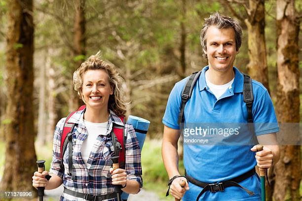 Happy Couple On Hike In Forest
