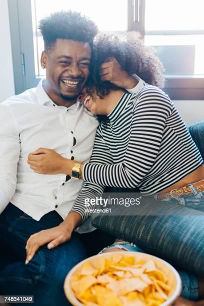 Happy couple on the sofa
