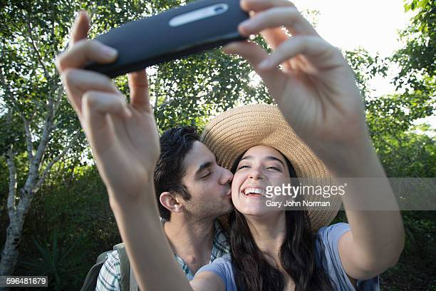 Happy couple on vacation taking selfie photo.