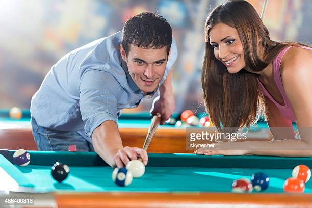 Happy couple people playing snooker.