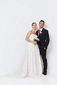 Beautiful happy couple in wedding attire, portrait