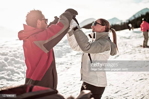 Happy couple playing in sparkling white snow