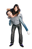 Young happy latin couple playing together piggyback isolated on white background.