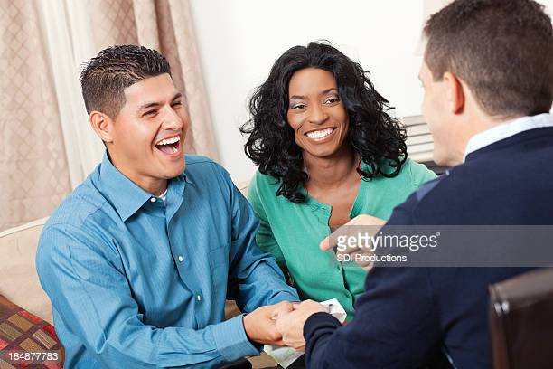 Happy couple receiving advice from financial advisor