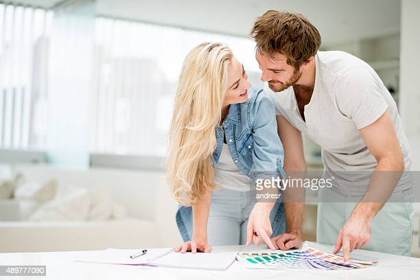 Happy couple redecorating their house
