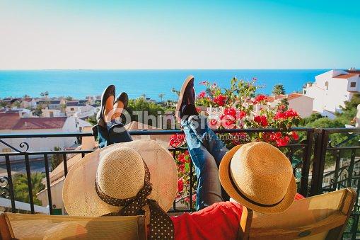 happy couple relax on balcony terrace : Stock Photo
