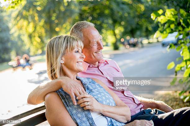 Happy couple relaxing at the park