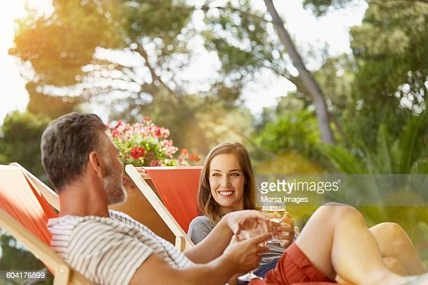 Happy couple relaxing on deck chair