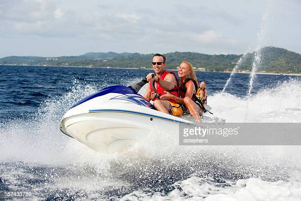 Happy couple ridding jetski