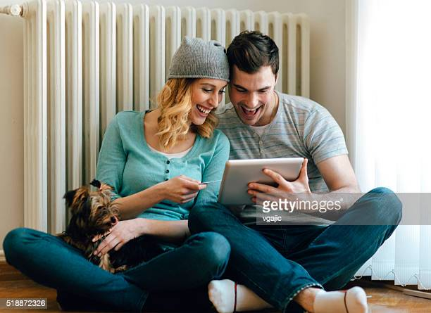 Happy Couple Shopping Online On Digital Tablet.