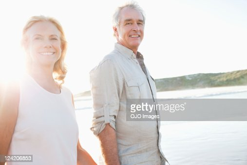 Happy couple smiling on beach : Stock Photo