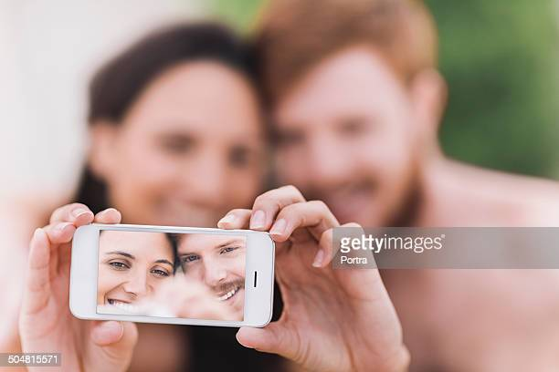 Happy couple taking self portrait