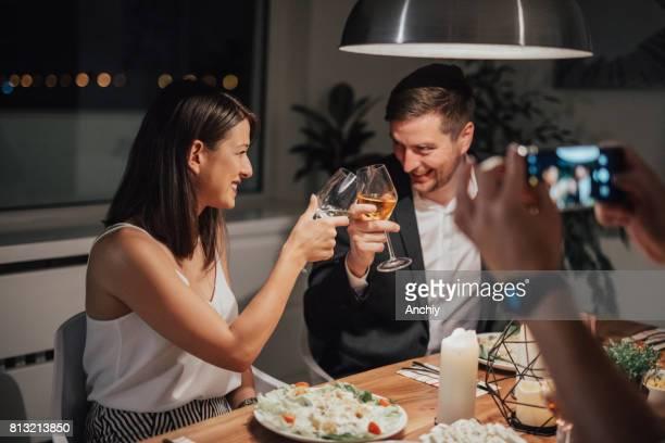 Happy couple toasting with wine glasses